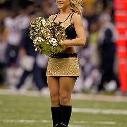 2009 November 30: New Orleans Saints Saintsations cheerleaders perform during a 38-17 win by the New Orleans Saints over the New England Patriots at the Louisiana Superdome in New Orleans, Louisiana.