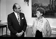 Brian Keenan's Sister Meets Minister Of Foreign Affairs.  (T6)..1989..07.09.1989..09.07.1989..7th September 1989..On the 11th April 1986, writer Brian Keenan was taken hostage in Beirut,he was kidnapped by a group purported to be the Islamic Jihad.As the British and American governments refused to negotiate with the kidnappers Mr Keenan was left in the hands of his abductors. As a holder of both Irish and British passports,his sisters, Elaine Spence and Brenda Gillham,pressed the Irish Government to intervene. At their behest the Irish Government opened talks with the Lebanese authorities to try and locate and free Mr Keenan. Elaine Spence visited the Department of Foreign Affairs to meet with Minister Collins to see what progress,if any, had been made...Image shows Ms Elaine Spence with Minister Collins (L) on her visit to the Dept of Foreign Affairs, Iveagh House, Dublin.