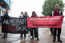 London, UK. 14th September, 2021. Peace Pledge Union supporters join Stop The Arms Fair activist at a protest outside ExCeL London on the first day of the DSEI 2021 arms fair. Activists from a range of different groups have been protesting outside the venue for one of the world's largest arms fairs for over a week.
