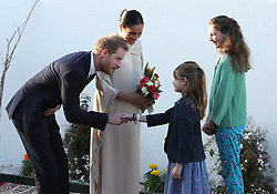 The Duke and Duchess of Sussex are greeted by Orla Reilly aged 12 and Elsa Reilly aged 8, the daughters of the British ambassador to Morocco, as they arrive for a reception hosted by the British Ambassador to Morocco at the British Residence in Rabat on the second day of their tour of Morocco.
