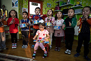"""Children perform during a music class in a kindergarten in one of the polluted ger district of the city, January 21, 2019. An ever-increasing number of children are suffering from respiratory  related illnesses in Ulaanbaatar, stretching health infrastructures to the limit. UNICEF Mongolia warned of a looming """"child health crisis"""" linked directly to the high pollution levels in the winter months."""