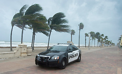 A police car patrols the beach in anticipation for Hurricane Irma, in Hollywood, Fla., Saturday, September 9, 2017. THE CANADIAN PRESS/Paul Chiasson
