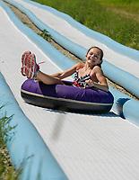 Megan Tierney takes a ride down the Tubing Hill at Gunstock Mountain Resort.  (Karen Bobotas/for the Laconia Daily Sun)