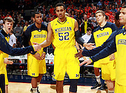 CHARLOTTESVILLE, VA- NOVEMBER 29:  Jordan Morgan #52 of the Michigan Wolverines runs through the huddle before the game against the Virginia Cavaliers on November 29, 2011 at the John Paul Jones Arena in Charlottesville, Virginia. Virginia defeated Michigan 70-58. (Photo by Andrew Shurtleff/Getty Images) *** Local Caption *** Jordan Morgan