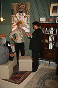 Carolina Herrera and Munnu Kasliwal ( who runs the Gem Palace) , Treasures From The Gem Palace, Private view of gem stones created by a family of Indian court jewellers from Jaipur (the Kasliwals). Somerset House, London, WC2, 28 September 2006. www.somerset-house.org.uk-DO NOT ARCHIVE-© Copyright Photograph by Dafydd Jones 66 Stockwell Park Rd. London SW9 0DA Tel 020 7733 0108 www.dafjones.com
