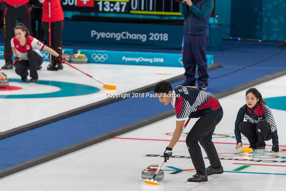 Lee Ki-jeong and Jang Hye-ji (KOR) competing in the Mixed Doubles Curling round robin at the Olympic Winter Games PyeongChang 2018