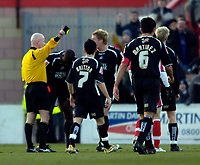 Photo: Jed Wee.<br />Doncaster Rovers v Swansea City. Coca Cola League 1.<br />17/12/2005.<br />Doncaster's Kevin Austin (C) is sent back to the dressing room by referee Dermott Gallagher (L) after only ten minutes.