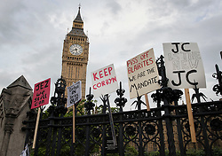 © Licensed to London News Pictures. 27/06/2016. London, UK.  Placards in support of Labour party leader Jeremy Corbyn adorn the railings outside Parliament. Labour Party Leader Jeremy Corbyn is making new appointments to his shadow cabinet after a number of resignations. Photo credit: Peter Macdiarmid/LNP