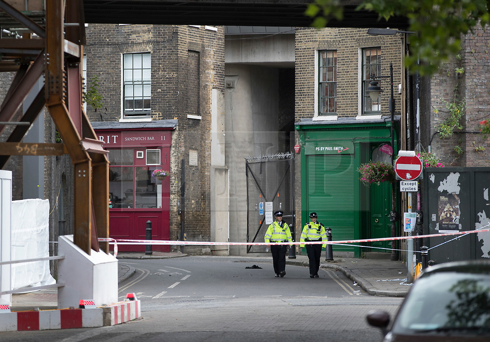 © Licensed to London News Pictures. 05/06/2017. London, UK. Police patrol in part of Borough Market after a terrorist attack on Saturday evening. Three men attacked members of the public after a white van rammed pedestrians on London Bridge. Ten people including the three suspected attackers were killed and 48 injured in the attack. Photo credit: Peter Macdiarmid/LNP