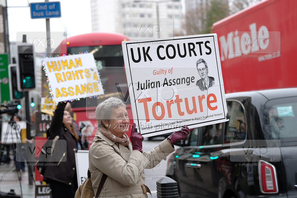 Supporters of Julian Assange hold banners and placards outside Westminster Magistrates Court in London on Friday, Dec 11, 2020. <br /> <br /> Assange, an Australian editor, publisher, and activist who founded WikiLeaks in 2006, is awaiting the decision of Judge Vanessa Baraitser as to whether he will be extradited to the United States. After just over 10 years in detention, Mr Assange facesup to175 yearsin prison for his role in publishing classified US documents which revealed allegations of war crimes and other crimes perpetrated by US-led forces inIraq,Afghanistanand US-occupiedGuantanamo Bay, Cuba. (VXP Photo/ Giovanni Strondl)