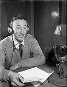 01/03/1956<br /> 03/01/1956<br /> 01 March 1956<br /> Radio Review special for Radio Eireann Junior Sorts Magazine show. Harry Thuillier, Presenter of Junior Sport Magazine show from Radio Eireann at R.E. Studios.