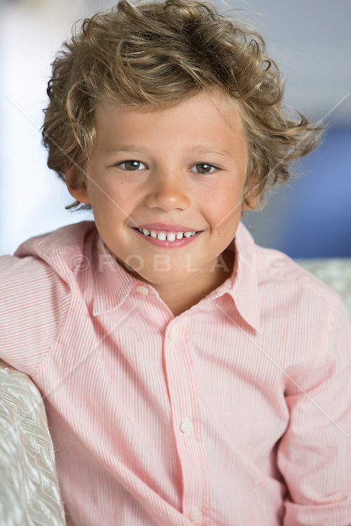 portrait of a little boy on a couch