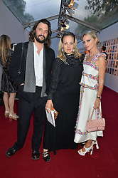 Left to right, TOM CRAIG, BAY GARNETT and LAURA BAILEY at British Vogue's Centenary Gala Dinner in Kensington Gardens, London on 23rd May 2016.
