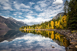 Reflections of autumn on Lake McDonald in Glacier National Park