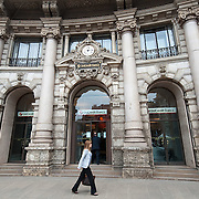 MILAN, ITALY - JUNE 07:  A woman walk past the head office of UniCredit Bank on June 7, 2010 in Milan, Italy. Today the Italian stock market suffered new losses in particular the banking sector and the Euro falls below $1.19, the lowest in over 4 years  (Photo by Marco Secchi/Getty Images)