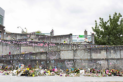 June 4, 2017 - Portland, Oregon, United States - Portland, Oregon: Shrine to the fallen heroes of the fatal stabbing on a MAX Light Rail train on May 26, 2017. A man fatally stabbed two people and injured a third, after he was confronted for shouting anti-Muslim racial slurs at two teenage girls at the Hollywood/NE 42nd Ave Transit Center. Hundreds of bouquets of flowers and messages of hope have been left for the victims in the week since the attack. (Credit Image: © Paul Gordon via ZUMA Wire)