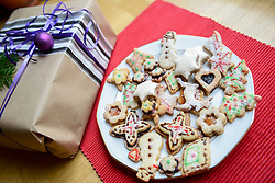 High angle view of gift box and gingerbread Christmas cookies in plate, Bavaria, Germany