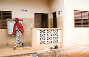 A woman walks out of the Adja-Ouere community health center in the village of Adja-Ouere, Benin on Friday September 14, 2007.