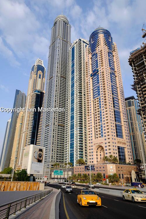 Street and modern skyscrapers in Marina District  in Dubai United Arab Emirates