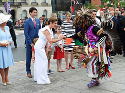 Sophie Gregoire Trudeau is given a feather by and indigenous dancer as Camilla Duchess of Cornwall and Prime Minister Justin Trudeau look on during Canada 150 celebrations in Ottawa, Canada, on Saturday, July 1, 2017. Photo by Adrian Wyld/CP/ABACAPRESS.COM