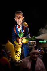 "© London News Pictures. 05/11/2013 . Lewes, UK. An effigy of Syrian president Bashar al-Assad with chemical weapons. Bonfire societies parade through the streets of Lewes, East Sussex, during as part of traditional bonfire night celebrations. Thousands of people line the narrow streets as bonfire societies parade in costume with the evening ending in the burning of the ""guy"". Bonfire Night marks the date of the uncovering of the Gunpowder Plot in 1605 and commemorates the memory of the seventeen Protestant martyrs. Photo credit : Ben Cawthra/LNP"