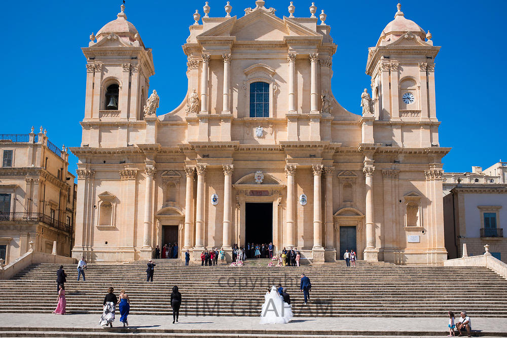 Bride arriving for wedding at Baroque style Cathedral of Saint Nicholas in Noto city, South East Sicily, Italy