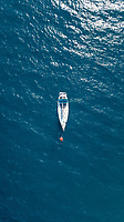 Aerial view of a sailing boat moored in mediterranean sea