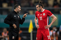 """Head coach Ryan Giggs, left, of Wales national football team instrucs his player Gareth Bale as they compete against Uruguay national football team in their final match during the 2018 Gree China Cup International Football Championship in Nanning city, south China's Guangxi Zhuang Autonomous Region, 26 March 2018.<br /> <br /> Edinson Cavani's goal in the second half helped Uruguay beat Wales to claim the title of the second edition of China Cup International Football Championship here on Monday (26 March 2018). """"It was a tough match. I'm very satisfied with the result and I think that we can even get better if we didn't suffer from jet lag or injuries. I think the result was very satisfactory,"""" said Uruguay coach Oscar Tabarez. Wales were buoyed by a 6-0 victory over China while Uruguay were fresh from a 2-0 win over the Czech Republic. Uruguay almost took a dream start just 3 minutes into the game as Luis Suarez's shot on Nahitan Nandez cross smacked the upright. Uruguay were dealt a blow on 8 minutes when Jose Gimenez was injured in a challenge and was replaced by Sebastian Coates. Inter Milan's midfielder Matias Vecino of Uruguay also fired at the edge of box from a looped pass but only saw his attempt whistle past the post. Suarez squandered a golden opportunity on 32 minutes when Ashley Williams's wayward backpass sent him clear, but the Barca hitman rattled the woodwork again with goalkeeper Wayne Hennessey well beaten."""