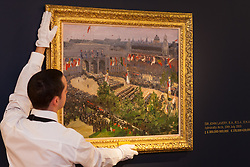 Sotheby's, London, December 5th 2014. World renowned aution house Sotheby's is to offer a collection of British and Continental masters to be sold at auction on December 10th 2014. PICTURED: A Sotheby's gallery technician hangs Sir John Lavery's celebrated painting of the 1919 London Victory Parade at Admiralty Arch. The painting has an estimated value of between £300,000 and £500,000.