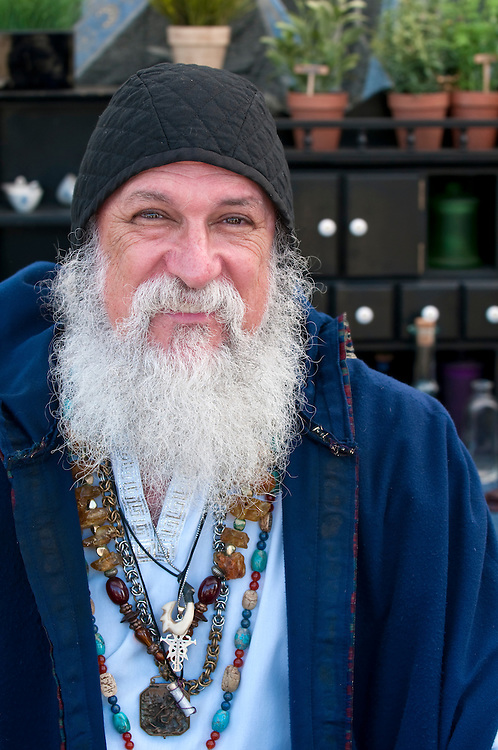 Old man, fortune teller smiling and looking at camera.