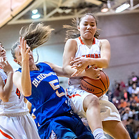 Gallup Bengal Journey Gillson (4), left, looks on as Bloomfield Bobcat Mattie Waresback (5) and Bengal Hanna Toledo (13) tie up for a rebound at Gallup High School Saturday.