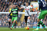 Erik Lamela of Tottenham Hotspur is intercepted by Leon Britton of Swansea City. Barclays Premier league match, Tottenham Hotspur v Swansea city at White Hart Lane in London on Sunday 28th February 2016.<br /> pic by John Patrick Fletcher, Andrew Orchard sports photography.