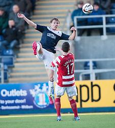 Falkirk's Stephen Kingsley over Hamilton's Lewis Longridge.<br /> half time : Falkirk 0 v 0 Hamilton, Scottish Championship game at The Falkirk Stadium. © Michael Schofield 2014.