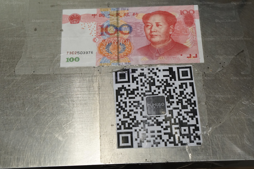 The note is a fake. Making the point that Cashless better than false money