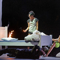 Picture shows : Simone James in background with match and fire.<br /> © Picture Drew Farrell <br /> Tel : 07721-735041. <br /> '365'<br /> World Premiere<br /> National Theatre of Scotland<br /> Textby David Harrower<br /> 365 has been created especially for the Edinburgh International Festival by the National Theatre of Scotland's Artistic Director Vicky Featherstone and written by David Harrower, one of Scotland's leading playwrights.<br /> 365 follows the lives of a group of young people who with their humour, imagination, wit and raw courage pass through the practice flat, taking their first faltering steps towards adulthood and the outside world.<br /> A Practice Flat is one of the state's mechanisms to gently introduce these children to the adult world. 365 is the story of a practice flat - a purpose-built witness to hopes, dreams, fear, opportunity and memory.<br /> <br /> Vicky Featherstone Director?Georgia McGuinness Designer?Steven Hoggett Movement Director?Adrienne Quartly Sound designer?Colin Grenfell Lighting designer?Paul Buchanan Songs<br /> Playhouse  Theatre, Edinburgh.<br /> First performance Friday 22nd August until Saturday 25th August 2008.<br /> <br /> © Picture Drew Farrell <br /> Tel : 07721-735041.