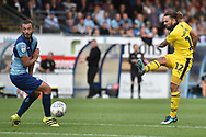 Oxford United midfielder (on loan from Sheffield United) Ricky Holmes) (12) takes a shot at goal during the EFL Sky Bet League 1 match between Wycombe Wanderers and Oxford United at Adams Park, High Wycombe, England on 15 September 2018.