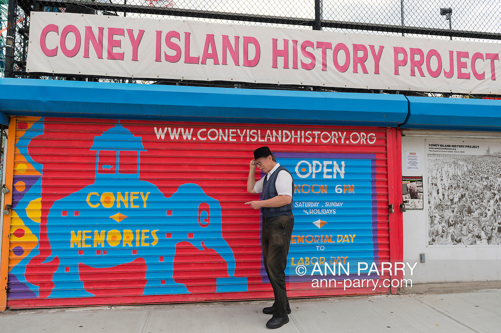 Brooklyn, New York, USA. 10th August 2013. BOB STUHMER, a member of AMICA, poses under the  Coney Island History Project banner over the booth where visitors can get information about the world famous neighborhood, beach and boardwalk and amusement park, during the 3rd Annual Coney Island History Day celebration.