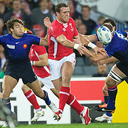 James Roberts, Wales, avoids the challenge of Imanol Harinordoquy, France, during the Wales V France Semi Final match at the IRB Rugby World Cup tournament, Eden Park, Auckland, New Zealand, 15th October 2011. Photo Tim Clayton...