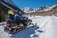 Snowmobiling on Maroon Creek Road in Aspen, Colorado.