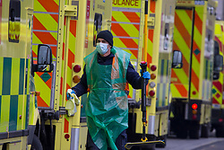 © Licensed to London News Pictures.15/01/2021, London,UK. A hospital worker prepares an ambulance for the next call out at  the Royal London Hospital in east London as the Covid-19 death toll in the UK rose by 1,248 yesterday, the third highest daily increase during the pandemic. Photo credit: Marcin Nowak/LNP