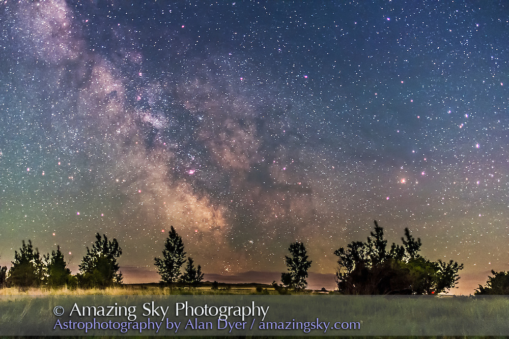 The centre of the Galaxy region in Sagittarius and Scorpius skimming the southern horizon on June 9, 2013 from home at a latitude of +51°. M6 and M7 clusters are just on the horizon. The sky was moonless but lit with perpetual twilight. Ground illumination is from starlight. This is a single 15-second exposure at f/1.4 with the 24mm lens and Canon 60Da at ISO 1600. Taken as part of a comparison pair with a 60 second exposure.