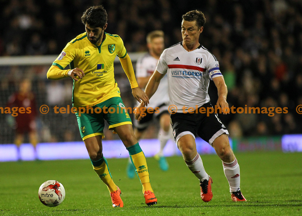 Nelson Oliveira fends off Scott Parker during the Sky Bet Championship match between Fulham and Norwich City at Craven Cottage in London. October 18, 2016.<br /> Jack Beard / Telephoto Images<br /> +44 7967 642437