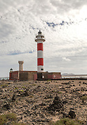 Red and white striped lighthouse, Faro de  Toston, El Cotillo,  Fuerteventura, Canary Islands, Spain