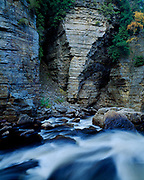 Elephant's Head, formation of Potsdam Sandstone carved by the Ausable River, Ausable Chasm, with blue line boundary of Adirondack Park, New York.