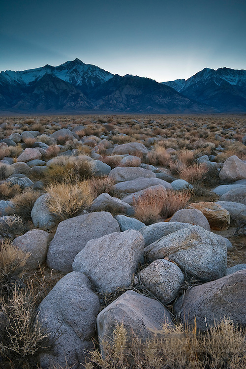 Rock field at sunset below the mountains of the Eastern Sierra, near Manzanar, California