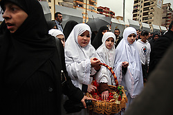 Young girls stand among Hezbollah members and supporters as they pay their respects to Imad Mugniyeh, the militant commander slain in a mysterious car bombing in Damascus, Syria. Mugniyeh a.k.a. Hajj Radwan, was among the most feared terror operatives in the world.