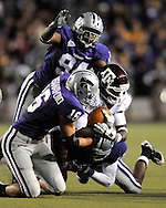 MANHATTAN, KS - OCTOBER 17:  Defenders Joseph Kassanavoid #16 and Raphael Guidry #94 of the Kansas State Wildcats tackle quarter back Jerrod Johnson #1 of the Texas A&M Aggies after picking up a first down in the second quarter on October 17, 2009 at Bill Snyder Family Stadium in Manhattan, Kansas.  (Photo by Peter G. Aiken/Getty Images)