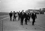 6/07/1967<br /> 07/26/1967<br /> 26 July 1967<br /> Taoiseach departs Dublin Airport for talks in Brussels. Taoiseach Jack Lynch left for Brussels where he would hold talks with regard to Ireland's application for membership of the Common Market accompanied by Mr. Hugh McCann, Secretary, Department of External Affairs. Picture shows the Taoiseach accompanied by his party and Belgian Ambassador Dr. Francis-Leo Goffert and Mr. M.J. Morgan, General Manager of Aer Lingus.