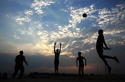 June 23, 2017 - Allahabad, Uttar Pradesh, India - Indian youth play bollyball at Sangam, the confluence of River Ganga, Yamuna and mythological Saraswati, during Sunset in Allahabad.<br />  (Credit Image: © Prabhat Kumar Verma via ZUMA Wire)