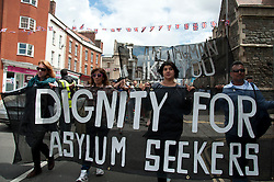 © Licensed to London News Pictures. 30/06/2012. Bristol, UK. Asylum seekers and supporters protest against the injustice and oppression they face and call for the right to asylum and justice, freedom and dignity for all. The demonstration was called by Bristol Refugee Rights. Photo credit : David Mirzoeff/LNP
